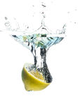 Fruit splash. Crystal clear water splashing from a fruit Stock Photo