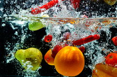 Fruit Splash on water. Various fresh and healthy fruit picture taken as they submerged dramatically into a clean water stock image