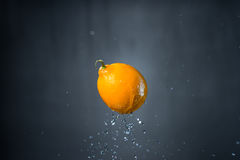 Fruit and splash of water.  Royalty Free Stock Photography