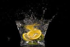Fruit splashing in water Royalty Free Stock Image
