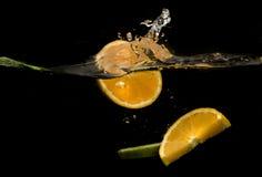 fruit splashing in the water Stock Photography