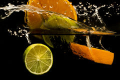 fruit splashing in the water Royalty Free Stock Photo