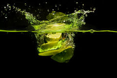 fruit splashing in the water Stock Photos