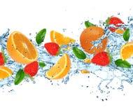 Fruit with splashing water Stock Photos
