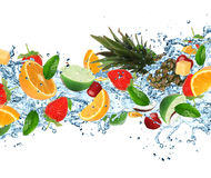 Fruit with splashing water Stock Images