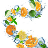 Fruit with splashing water Stock Photos