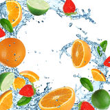 Fruit with splashing water. Over white Stock Image