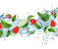 Fruit with splashing water Royalty Free Stock Image