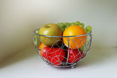 Fruit in the stainless basket Royalty Free Stock Photos