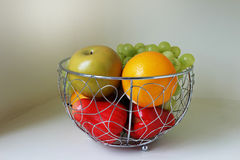 Fruit in the stainless basket Royalty Free Stock Photography