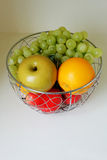 Fruit in the stainless basket Royalty Free Stock Images