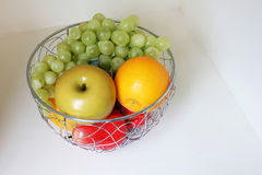 Fruit in the stainless basket Royalty Free Stock Image