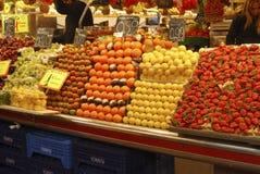 Fruit stall in covered market. Barcelona. Spain. Market stall selling fresh fruit. In La Boqueria covered market. Barcelona. Catalonia. Spain stock photo