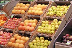 Fruit Stand. Organic fruit stand with display of grapefruits, peaches, nectarines, plums and pears Stock Photos