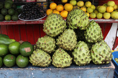 Fruit Stand with Chirimoya. Fruit stand in Peru with Chirimoya, avocado and lemons Stock Photos