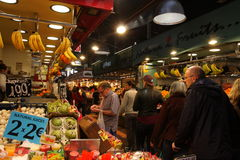 Fruit stand and customer at la Boqueria,Barcelona Royalty Free Stock Photos