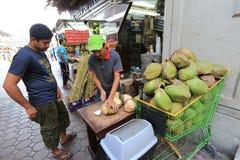 Fruit stand in dubai. Fruit stand selling coconut in dubai, United Arab Emirates Stock Image