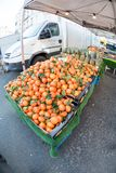 Fresh oranges in market in Brussels. A fruit stand with fresh oranges and other fruits in Brussels, Belgium, on 18th February 2018 Royalty Free Stock Photos