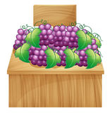 A fruit stand for grapes with an empty signage stock illustration