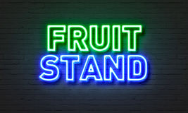Fruit stand neon sign on brick wall background. Stock Image