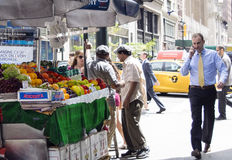 Fruit Stand in New York City. Display of fruit for sale on a busy corner in  midtown Manhattan at  5th Avenue and 37th Street Stock Images