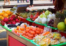 Fruit Stand with a Rich Selection of Tropical Fruits Stock Images