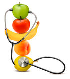 Fruit with a stethoscope. Healthy diet concept. Stock Photography