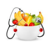 Fruit with a stethoscope. Healthy diet concept. Royalty Free Stock Photo