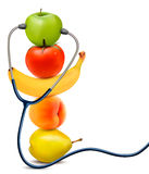 Fruit with a stethoscope. Healthy eating concept. Royalty Free Stock Photo