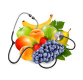 Fruit with a stethoscope. Healthy eating concept. Stock Image