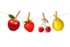 Fruit stickers hanging on a rope. Stock Images