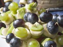 Fruit sticks. Banana, grapes and kiwi fruit on sticks Stock Image