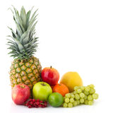 Fruit still life. With ananas apples orangens and grapes Royalty Free Stock Images