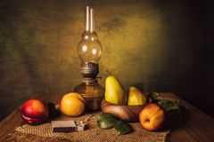 Fruit Still Life. With pears, nectarines and an old kerassene lamp Stock Photos