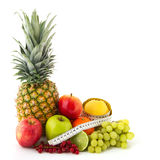 Fruit still life with measurement tape Royalty Free Stock Image