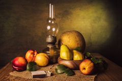 Fruit Still Life. With pears, nectarines, melon and an old kerassene lamp Stock Image