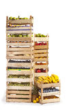 Fruit stored in wooden crates on white background. Various types of fruit and vegetables stored in wooden crates Royalty Free Stock Photography
