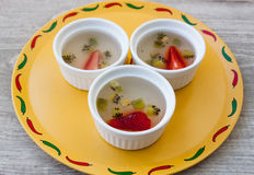 Fruit strawberry and kiwi jelly dessert on the wood background Royalty Free Stock Images