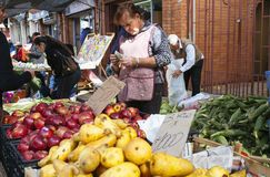 Fruit in street market. Cauquenes, Chile. April 30, 2016. Unidentified person dealer in popular street market Royalty Free Stock Images
