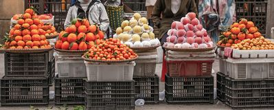 Fruit street vendors at Lao Kai, Vietnam-China border. Vietnamese woman street venders with orange, apple, chinese pear and. Mangoes. Colorful of fruits in royalty free stock image