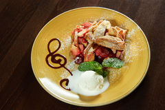 Fruit strudel with a scoop of ice cream Royalty Free Stock Images