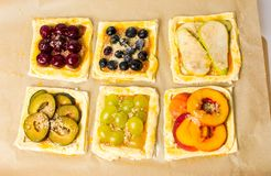 Fruit sweet pies before baking. Home made fruit sweet pies before baking Royalty Free Stock Photo