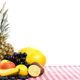 Fruit on tablecloth textile Stock Photos
