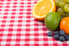 Fruit on tablecloth textile Stock Image