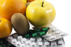 Fruit and tablets. Royalty Free Stock Image