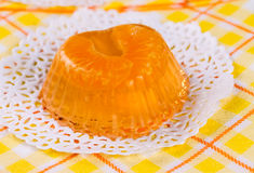 Fruit tangerine jelly. On white lacy napkin Stock Image