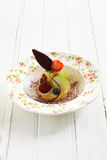 Fruit tart. With fresh fruit like kiwi, blueberry, rassberry, cherry, styling with chocolate piece and cocoa powder Stock Image