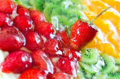 Fruit tart. Fruit and vanilla tart with assorted fruits. Shallow depth-of-field, focus on strawberry Stock Photography