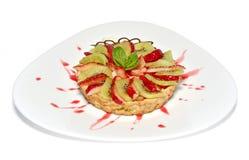 Fruit tart. On white plate Royalty Free Stock Images