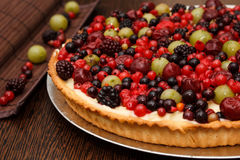Fruit tart. A creamy cake with plenty of fruits stock photography